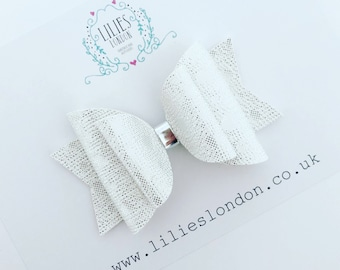 White and silver shimmer bow