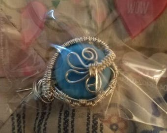 Silver and blue wire wrapped pendant