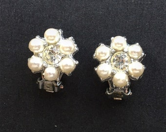 Small and elegant Vintage clip on earrings in floral designwith pearl petals and rhinestone center