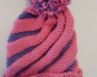 Hand Knitted Infant Swirl hat with pompom, fits newborn to 9 months pink and lavendar