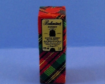 Dollhouse Miniature accessory in twelfth scale or 1:12 scale. Bar accessory.  Scotch Whiskey box .    Item #D458.