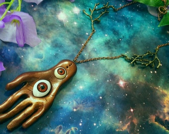 Palmistry mystic hand with eyes and branch charms