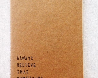 Moleskine style notebook hand stamped message always beliece that something Wonderful is about to happen - Valentinequote