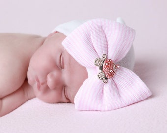 Princess Carriage Newborn Hospital Hat, white hat with a pink stripe bow & pink and rhinestone carriage from Lil Miss Sweet Pea Boutique