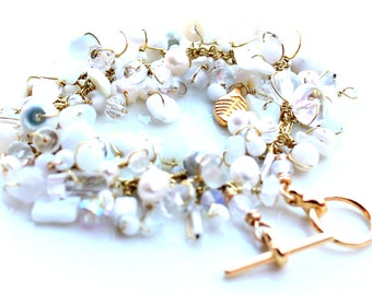 white gold bracelet. beaded wire wrapped bracelet white beads gold wrapped