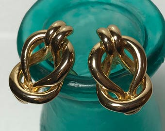 Vintage gold tone clip on Gay Boyer earrings