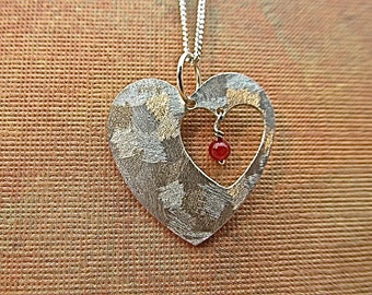 Sterling silver heart pendant with red quartz