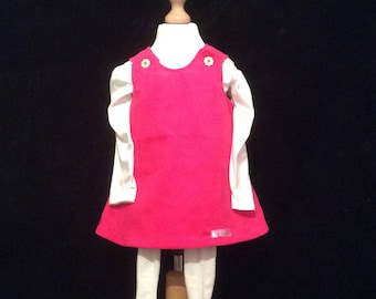 Pretty Pink Cordoroy reversible  pinafore .