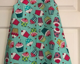Mint green cupcake dress with hot pink and white polka trim.