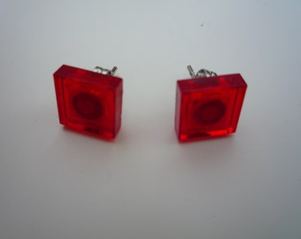Red translucent shiny square earring studs made from Lego® bricks.