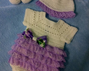 Crochet white romper with lavender lace ruffles, comes with hat and shoes.