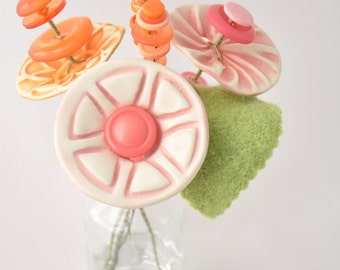 pink and orange button flower bottle bouquet