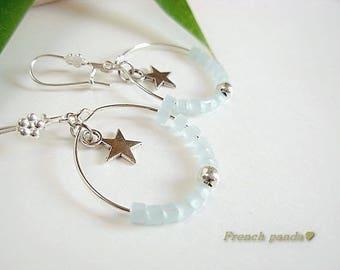 Silver hoop earrings, blue glass beads