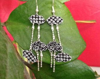 Black clouds shrink plastic earrings.