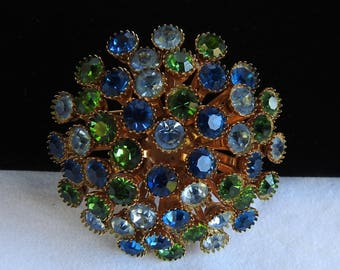 Vintage Gold Tone Mid Century Round Domed Atomic Abstract Flower with Aquamarine, Sapphire Blue, & Emerald Green Rhinestones Brooch