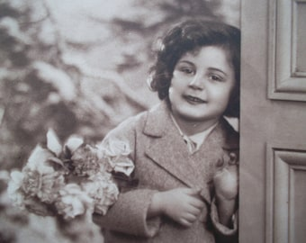 vintage postcard of a lovely girl with flowers