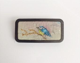 Embroidered bird brooch