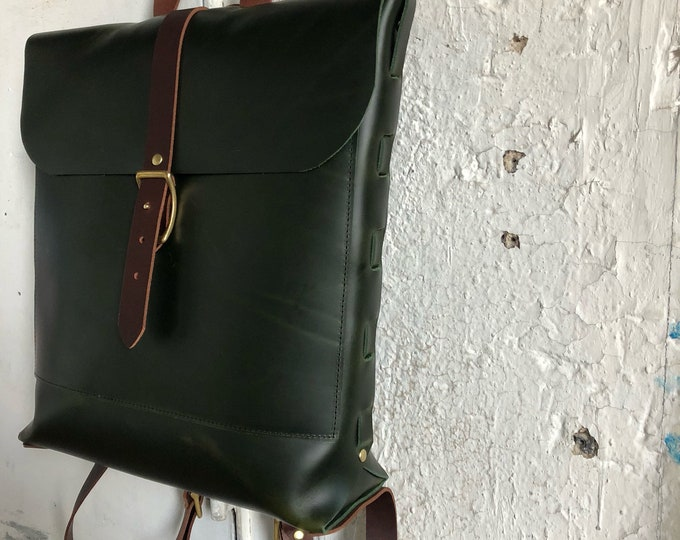 Racing green convertible rucksack.