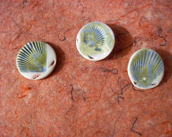 Clay buttons with shell motif!