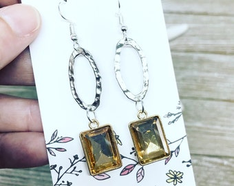 Mixed metal earrings with beautiful champagne color crystal.