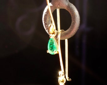 Emeralds and gold earrings