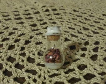 Miniature Glass Bottle Filled With Red Rose Petals