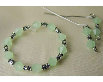 Stunning light jade green crystal and tibetan silver Barbie necklace and earring set.  Handmade by Nims