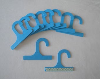 Plastic hangers with adhesive pad