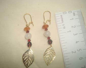 Falling leaves with red agates and glass beads.