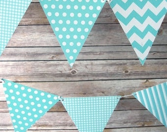 Light blue triangle flag pennant banner, light blue baby shower decor, its a boy decor, light blue triangle banner. Item: 12FGBUNT-TBPAT