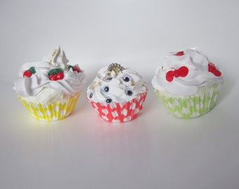 3 dummy fake cupcakes bows cherries white icing. Eyeballs gold dust topping. Photo prop Kitchen decor. Cake Shop display