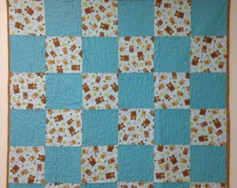 Sale  was 59.00 now 49.00  Baby boy quilt, blue quilt with brown bears and dots on the front  Moon, stars and hearts on the backing,
