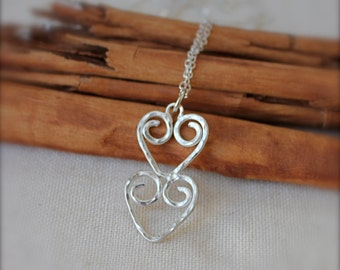 Hearts Necklace. Sterling silver Hearts Pendant. Two swirly hearts. Hammered texture design. Anniversary. Gift for her.
