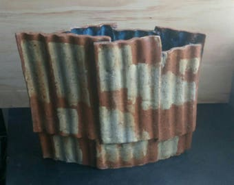 Large vessel, corrugated clay