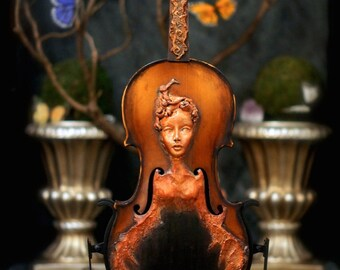 Violin Spirit. Original Sculpture by Award Winning Fae Factory Visionary Artist Dr Franky Dolan (clay and musical instrument violin art)