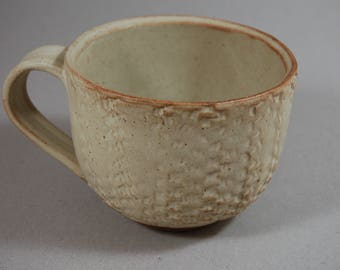 Pale yellow stoneware  coffee cup