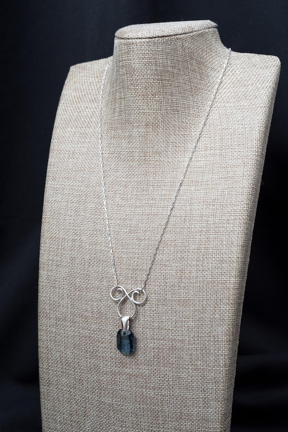 """Handmade necklace with a Sterling Silver Swirl focal and a Large """"Graphic"""" Swarovski Crystal embellishment."""