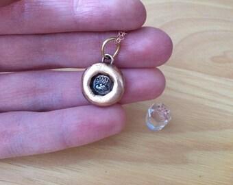 Adieu wax seal pendant with setting sun