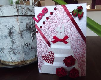For wedding congratulations card. wedding cake with red flowers