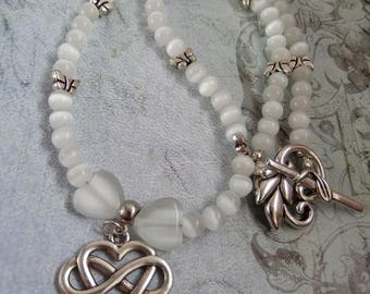 White Cats Eye Beaded choker Necklace with Tibetan Silver Butterflies and Infinity Heart Charm and Toggle Fastening