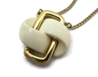 Mid Century Modern Necklace - Trifari, Gold Cream Lucite Knot Pendant, MCM Costume Jewelry
