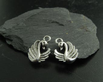 4 silver Swan charms