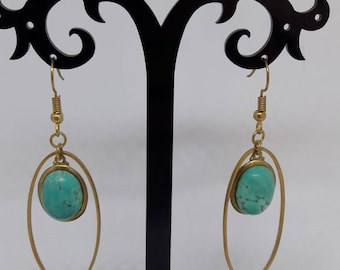 gold ring with turquoise stone earrings