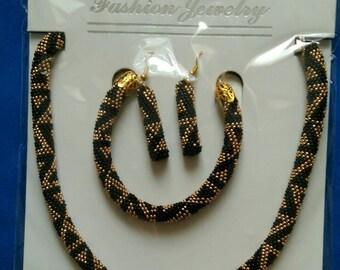 Bead crochet necklace bracelet and earrings.