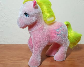 Shady is one of My Little Pony's first generation of flocked ponies called So Soft Ponies and is covered with peachy-pink fuziness