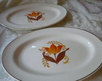 Midcentury Modern Pair of Bakerite Modren Tulip Platters