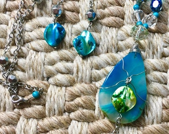 Blue crystal and natural stone wire wrapped pendant necklace set.