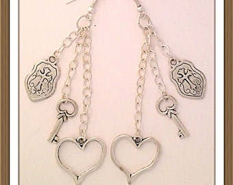 Handmade MWL long dangle heart and criss earrings. 0068