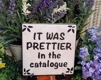 """Funny Garden Sign """"It was prettier in the catalogue"""""""
