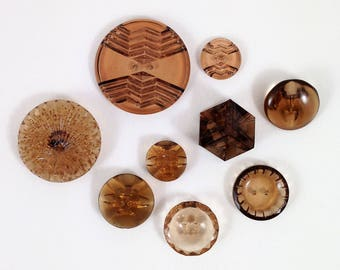 Group of Nine Vintage Clear Glass Buttons with Art Deco Style in a Chocolate Brown Color